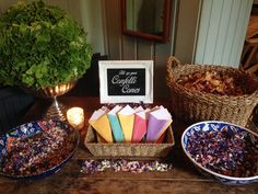 Confetti bar with colourful bowls filled with dried petals & cones for guests to fill when the photographer says 'confetti time!' www.littleweddinghelper.co.uk