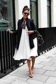 White billowy dress, leather jacket, statement necklace