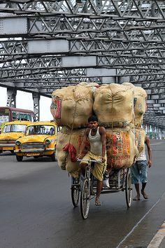 Crossing Howrah bridge in Kolkata, India.