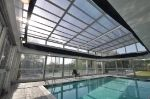 Roll-A-Cover's Retractable Pool Cover at Holiday Inn Express in Milford, CT. Guests can swim year-round under this retractable skylight and rolling wall system. Retractable Pool Cover, Pool Enclosures, Outdoor Pool, Outdoor Decor, Roofing Systems, Glass Roof, Condominium, Skylight, Swimming Pools