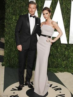 Victoria Beckham in her own design. Boring. But she has the best accessory EVER.