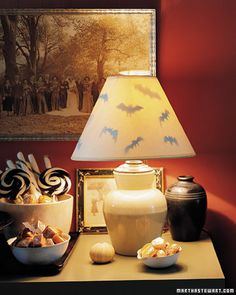 Your visitors will shudder when they spot a bat-lined lampshade as part of your decor. Some of the paper cutouts are suspended from threads, while others are stuck inside the shade.