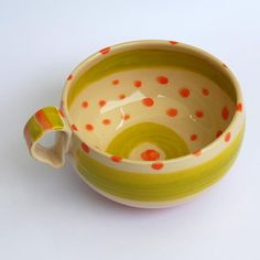 Orange polka dot cup coffee or tea cup by PotsbyNives on Etsy.
