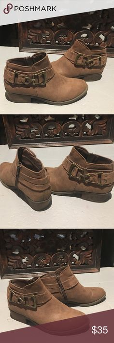 Carlos Booties. Brown Size 8.5 New Carlos booties with unique buckle very cute.  I only wore once. New Year's resolution -reduce shoe count. My loss your gain. Soft to touch. Great buy. Carlos Santana Shoes Ankle Boots & Booties