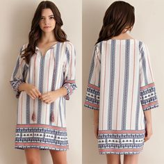 MISTEE shift dress with tassels - NAVY Border print textured fabric V-Neck shift dress featuring tassels on neckline. Unlined. Non-Sheer. Woven. Lightweight.    100%POLYESTER  NO TRADE, PRICE FIRM Dresses