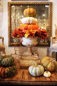 Grab your old urn, any size will do and stack it with preserved leaves and colorful pumpkins for a dramatic display! ONEAND2.COM