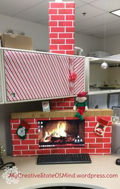 OFFICE FIREPLACE: out of cardboard boxes made to fit over computer monitor. Desktop background changed to fireplace photo #office #cubicle #desktop #fireplace #christmas #holidays #elfonshelf VISIT MY BLOG for more crafty stuff <3