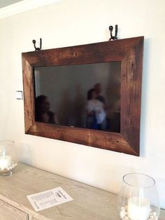 TV in frame hung with drapery hardware a great way to hide your TV.  #thefamilymark www.thefamilymark.com