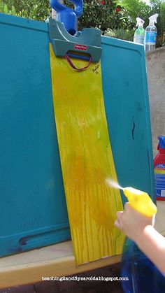 Teaching 2 and 3 Year Olds: Outdoors  Spray painting with water colors.