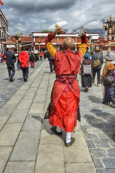 A Tibetan monk prostrating around Lhasa's Jokhang Temple. Photo taken May 2014.