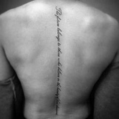 Simple Cursive Lettering Quote Spine Tattoo On Man