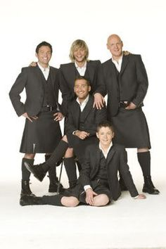 Celtic Thunder plus Neil Byrne not pictured here ...who sang backup and played in CT band before Sharon brought him up front as a permanent member of the principal singers.