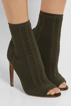 b6394baf901 Heel measures approximately 4 inches Army-green stretch-knit Pull on Made  in Italy