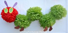 Hungry caterpillar-inspired pom creation by PomPomMomma on Etsy.  $24.95.