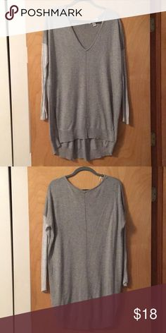 Forever 21 Gray V Neck Sweater Forever 21 Gray V Neck Sweater with light gray sleeves and it is longer in the back. The front has open slits. Perfect with leggings or jeans! Forever 21 Sweaters V-Necks
