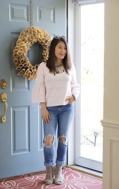 Pink bell sleeve top, ripped jeans, sand peep toe booties