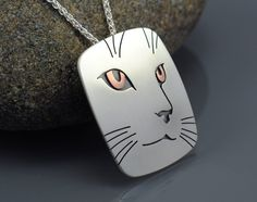 Cat Portrait Pendant Necklace - Sterling Silver and Copper. $88.00, via Etsy.