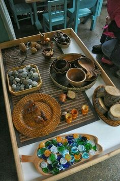 Loose parts- stones, flat marbles, twigs, containers