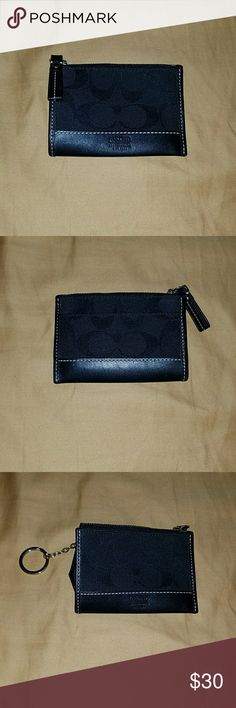 🌌 Coach Coin & Card Holder 🌌 This is a beautiful coach black coin holder that has a circular key fob to put on your keys or attach to your bag. In perfect condition. Zipper opening for coins and one slot in the back for credit cards. Matching Coach purse and wallet are in my closet if you'd like to take a look. Open to offers but no trade offers please as I'm trying to purge my closet. Happy Poshing!!! Coach Accessories