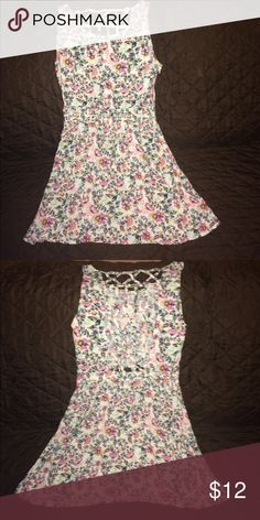 Floral dress Floras dress it has a really cute back. its size 8 but is more like a small Dresses