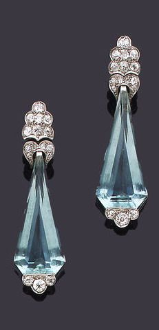 A pair of diamond and aquamarine pendent earrings ~ Each kite-shaped aquamarine drop to an old brilliant and single-cut diamond terminal and surmount, diamonds approx. 1.40ct. total, length 5.3cm., fitted case