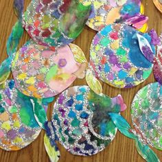 Watercolor Rainbow Fish! Beautiful! Could have K1 color with crayola markers and use paintbrush and water to make watercolor. Glue glitter or sparkles when dry.