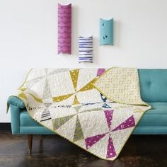 This quilt is awesome. We love that the fabric used to make the windmills is filled with wind themes.  http://www.freequiltpatterns.info/free-pattern---windmill-quilt-by-rashida-coleman-hale-for-cotton-and-steel.htm