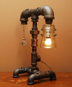 Industrial Style Pipe Lamp with Clear Glass Insulator and Pull Chain Switch.