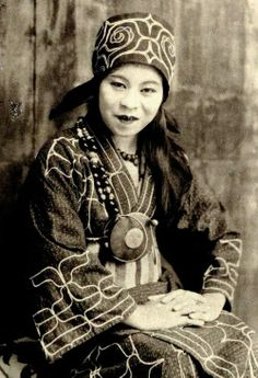 An Ainu woman, one of the indigenous people of northern Japan, in traditional garments, 1890s