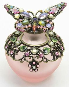 Pink Butterfly Perfume Bottle.  This is so pretty.  My perfume would look so much nicer in a pretty bottle like this.