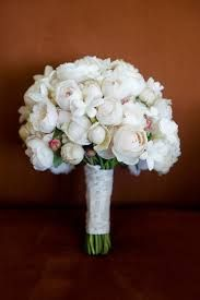 Assorted varieties of white David Austin roses make a beautiful bridal bouquet.