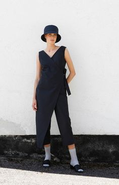 V-neck wrap jumpsuit in coal black. Sustainable design: made from repurposed Finnish rental textiles. Wrap Jumpsuit, Neck Wrap, Sustainable Fashion, Knit Dress, Confidence, Normcore, Slim, Cotton, How To Wear
