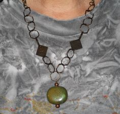 Green bead on metal necklace