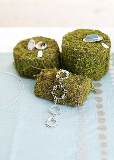 moss-covered Styrofoam pieces makes for an interesting display for jewelry - and you can cut it into any shape