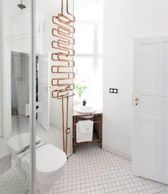 the Autor Rooms hotel in Warsaw modern white bathroom with exposed copper / via coco+kelley