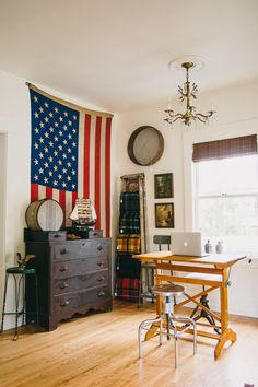 WELCOME TO HOMESTEAD 05 | Antique dresser, Hamilton drafting table, US flag, plaid blankets, industrial stools, antique grain sifter.