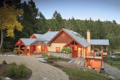 The in-floor radiant heat is geothermal, sourced from the property's commercial trout ponds – a highlight of the landscaping. Custom Home - Victoria BC by Road's End Contracting Custom Home Builders, Custom Homes, House On A Hill, Natural Materials, Home Projects, This Is Us, Radiant Heat, Cabin, Ponds