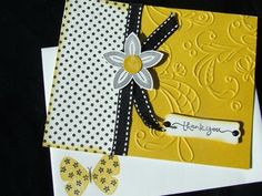 Cute card!  Love the embossing and the black/yellow color scheme!