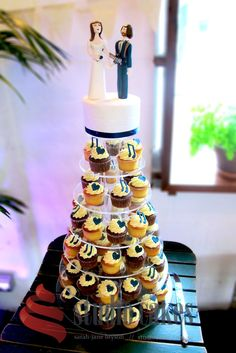 Cupcake tower for musicians Tom and Bec. Complete with hearts and music notes in navy blue and topped with personalised wedding toppers. By Studio Cakes www.studiocakes.com.au