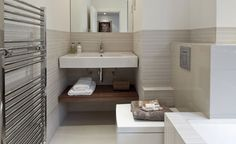 Make an ensuite feel larger by hiding pipework