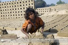 India: A 9-year-old girl toils under the hot sun, making bricks from morning to night, seven days a week. She was trafficked with her entire family from Bihar, India, and sold to the owner of a brick-making factory. As part of UNODC's anti-trafficking efforts, the organization works to tackle all forms of this crime, including persons trafficked for sexual exploitation, labour, domestic servitude and organs. For more, visit…