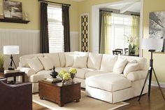 "The Kinning 3-Piece Sectional from Ashley Furniture HomeStore (AFHS.com). With the casual contemporary slipcover look along with the light twill fabric, The ""Kinning-Linen"" upholstery collection features large rolled set-back arms and supportive boxed cushions that add comfort to the relaxed airy design this furniture brings to any home's décor."