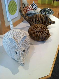 Tom Meunick armadillos....available for purchase at The South Bend Museum of Art...I MUST HAVE!!!