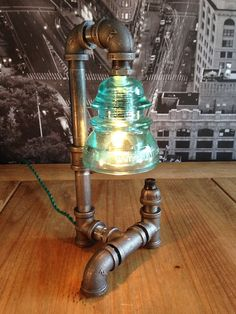 Steampunk Vintage Industrial Whitall Tatum Insulator Pipe Lamp by TheVintageBulb on Etsy https://www.etsy.com/listing/213765001/steampunk-vintage-industrial-whitall