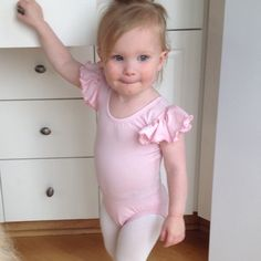 """Fits perfectly and is so cute. Looks very well made. The tag states that the washing instructions are hand wash only. Did not know this prior to purchase but am hoping I can care for it the same as I do for other ""unmentionables"".  Can't wait for dance class to start!!!"" Review of LIGHT PINK Toddler & Girls Leotard Flutter / Ruffle Short Sleeve for Ballet and Gymnastics"