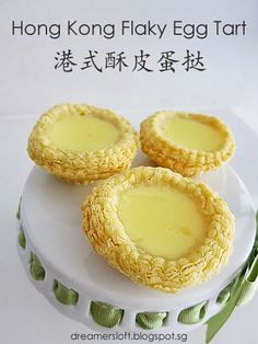 I believe the egg tart needs no elaborate introduction 🙂 Basically there are two types of tart shell, the cookie-pastry base (饼皮) and the p… Tart Recipes, Cupcake Recipes, Snack Recipes, Dessert Recipes, Flaky Egg Tart Recipe, Hong Kong Egg Tart Recipe, Hk Egg Tart Recipe, Chinese Egg Tart, Chinese Food