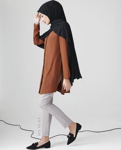INAYAH | Minimal, easy-to-wear and comfortable; the perfect option for the modest working woman and her workwear wardrobe! - Rust #Collarless #Midi with #Slits + Dove Grey Straight Leg #Trousers Black Rayon Blend Jersey #Hijab - restocking soon www.inayah.co