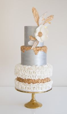 Vintage wedding cake with edible wafer paper feathers and sequins.