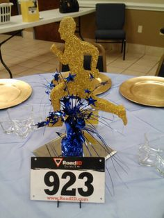 Banquet centerpieces #centerpieces #runner #bib numbers # table numbers #marathon #track & field # cross country #team voices