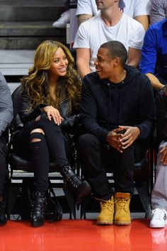 """We love Beyoncé's court side style! The singer always looks *oh* so chic.  TheLemonade singer proved""""all black everything"""" is a no-fail outfit choice, especially when accented with ripped jeans and heeled combat boots."""